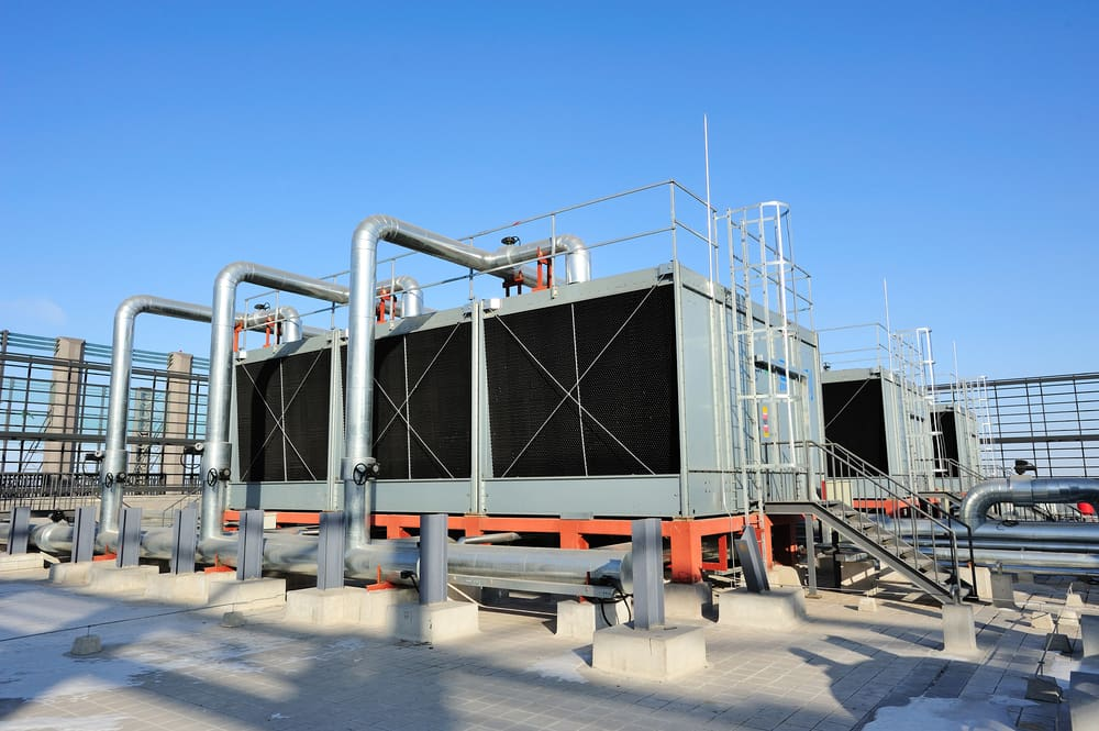 What is the difference between air-cooled and water-cooled chillers